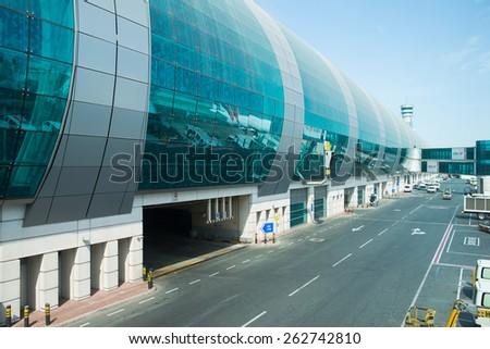 DUBAI, UAE - MAY 16: Dubai International Airport building. Dubai International Airport is an international airport serving Dubai. It is a major airline hub in the Middle East - stock photo