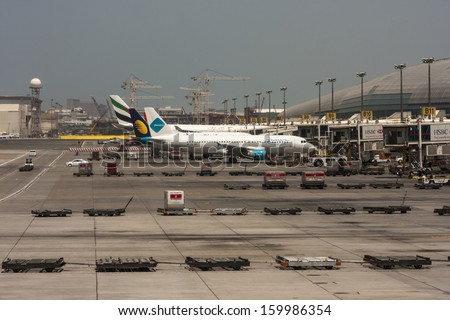 DUBAI, UAE - MAY 19: Dubai International Airport, one of the busiest airports, as seen on May 19, 2013. It is a major airline hub in the Middle East, and is the main airport of Dubai.  - stock photo