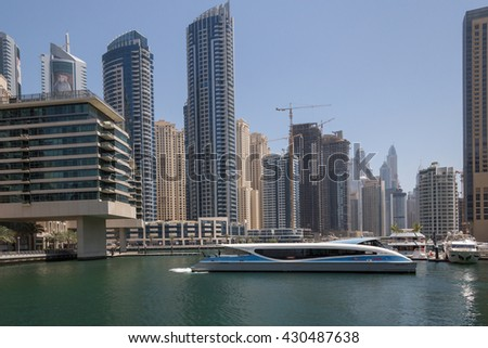 DUBAI, UAE - MAY 15, 2016: ferry in gulf of district Marina in Dubai