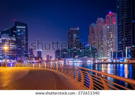 DUBAI, UAE - MAY 14: Futuristic buildings in Dubai Marina, Dubai, UAE. In the city of artificial channel length of 3 kilometers along the Persian Gulf, taken on 14 May 2014 in Dubai. - stock photo