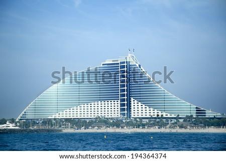 DUBAI, UAE -  MAY 10:Jumeirah Beach Hotel on May 10, 2014 in Dubai.  9th tallest building in Dubai  - stock photo