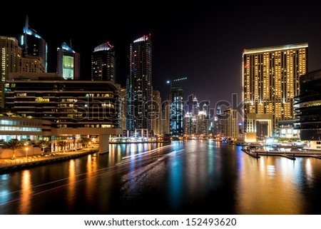 DUBAI, UAE - MAY 3: Night view at modern skyscrapers in Dubai Marina on May 3rd 2013 in Dubai. Dubai Marina - artificial canal city, carved along a stretch of Persian Gulf shoreline. - stock photo