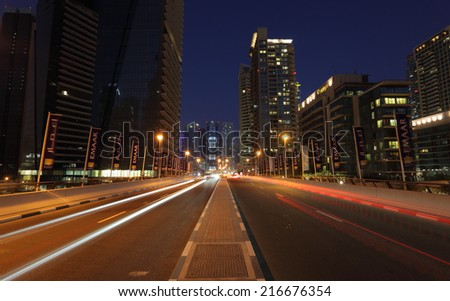 DUBAI, UAE - MAY 28: Road at night downtown in Dubai Marina. May 28, 2011 in Dubai, United Arab Emirates  - stock photo