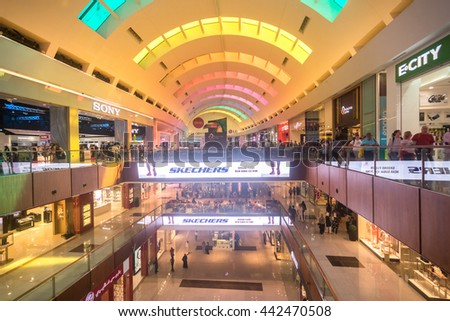 DUBAI, UAE - MAY 16: Shoppers at Dubai Mall on May 14, 2016. At over 12 million sq ft, it is the world's largest shopping mall based on total area and 6th largest by gross leasable area. - stock photo