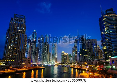 DUBAI, UAE - NOV 21, 2014 : View of modern skyscrapers in Jumeirah beach residence on November 21, 2014 in Dubai, JBR - artificial canal city, carved along a 3 km stretch of Persian Gulf shoreline.