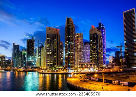 DUBAI, UAE - NOV 16, 2014 : View of modern skyscrapers in Jumeirah beach residence on November 16, 2014 in Dubai, JBR - artificial canal city, carved along a 3 km stretch of Persian Gulf shoreline. - stock photo