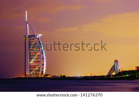 "DUBAI, UAE-NOVEMBER 17: A general view of the world's first seven stars luxury hotel Burj Al Arab ""Tower of the Arabs"" on November 17, 2012 in Dubai. Also known as ""Arab Sail"" - stock photo"