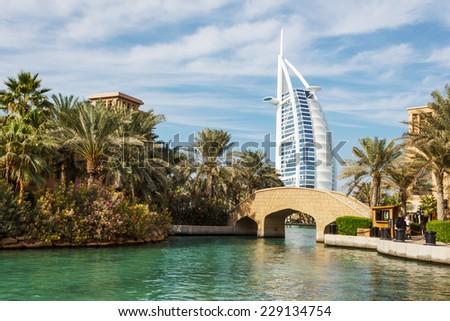 "DUBAI, UAE - NOVEMBER 15: A general view of the world's first seven stars luxury hotel Burj Al Arab ""Tower of the Arabs"", also known as ""Arab Sail"" on November 15, 2012 in Dubai, UAE - stock photo"