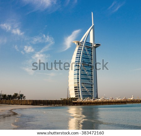 "DUBAI, UAE-NOVEMBER 15: A general view of the world's first seven stars luxury hotel Burj Al Arab ""Tower of the Arabs"" on November 15, 2012 in Dubai. Also known as ""Arab Sail"" - stock photo"