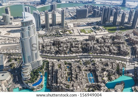 DUBAI, UAE - NOVEMBER 13: Address Hotel and Lake Burj Dubai in Dubai. The hotel is 63 stories high and feature 196 lavish rooms and 626 serviced residences, taken on 13 November 2012 in Dubai. - stock photo
