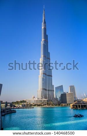 DUBAI, UAE - NOVEMBER 13: Burj Khalifa on November 13, 2012 in Dubai, UAE. Burj Khalifa is currently the tallest building in the world, at 829.84 m (2,723 ft). - stock photo