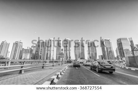 DUBAI, UAE - NOVEMBER 22, 2015: City skyline and buildings. Dubai attracts more than 10 million visitors annually. - stock photo