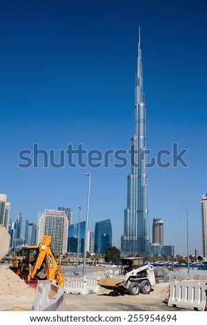 DUBAI, UAE-NOVEMBER 13, 2013: Construction of modern buildings in Dubai, UAE - stock photo