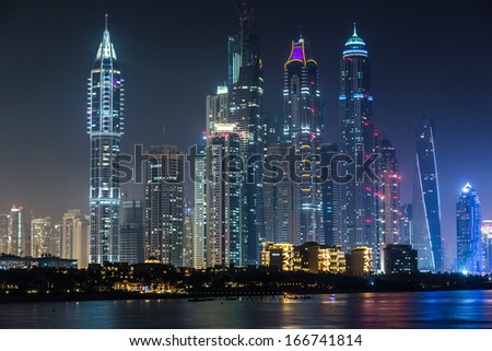 DUBAI, UAE - NOVEMBER 13: Dubai downtown night scene with city lights, luxury new high tech town in middle East, United Arab Emirates architecture. Dubai Marina cityscape, UAE