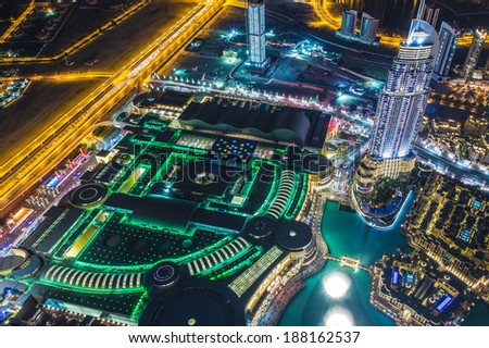 DUBAI, UAE - NOVEMBER 13: Dubai downtown night scene with city lights, luxury new high tech town in middle East, United Arab Emirates architecture
