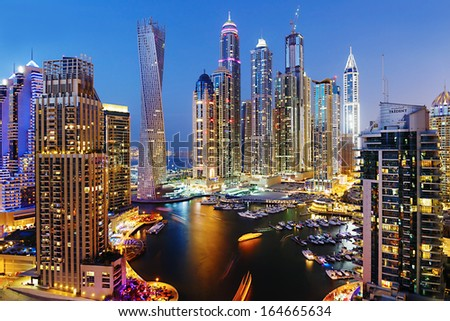 DUBAI, UAE - NOVEMBER 2: Dubai Marina at Dusk from the top, on November 2, 2013, Dubai, UAE. In the city of artificial channel length of 3 kilometers along the Persian Gulf. - stock photo