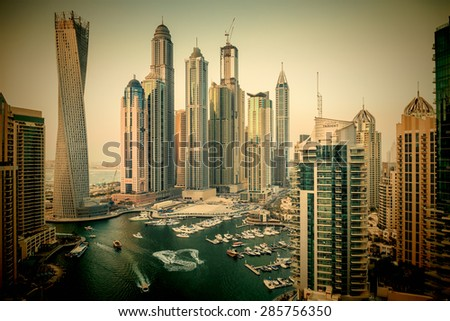 DUBAI, UAE - NOVEMBER 2: Dubai Marina at Dusk from the top, on November 2, 2013, Dubai, UAE. In the city of artificial channel length of 3 kilometers along the Persian Gulf. Toned