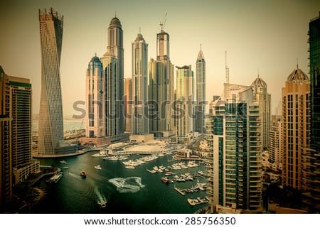 DUBAI, UAE - NOVEMBER 2: Dubai Marina at Dusk from the top, on November 2, 2013, Dubai, UAE. In the city of artificial channel length of 3 kilometers along the Persian Gulf. Toned - stock photo