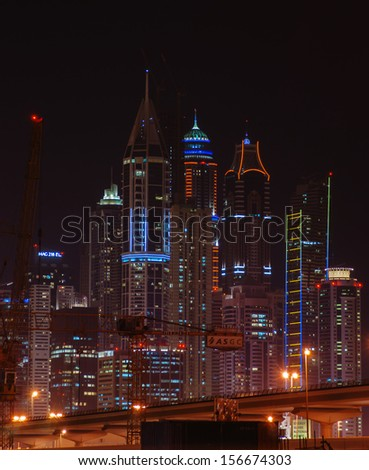 DUBAI, UAE - NOVEMBER 14: Dubai Marina at night, on November 14, 2012, Dubai, UAE. In the city of artificial channel length of 3 kilometers along the Persian Gulf.