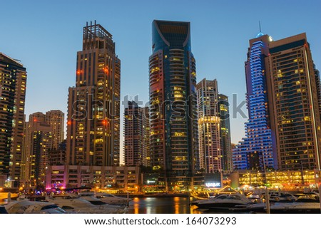 DUBAI, UAE - NOVEMBER 16: Dubai Marina at night, on November 16, 2012, Dubai, UAE. In the city of artificial channel length of 3 kilometers along the Persian Gulf.
