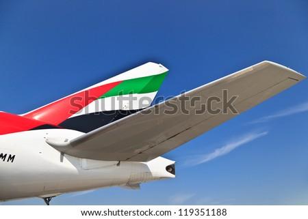 DUBAI, UAE - NOVEMBER 10: Emirates Airbus tail at Dubai Airport on November 10, 2012 in Dubai, UAE. Emirates handles major part of passenger traffic and aircraft movements at the airport. - stock photo