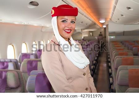 Dubai, UAE - NOVEMBER 9, 2015: Emirates Airline cabin crew member, flight attendant. Airbus A380 interior on November 09, 2015 in Dubai - stock photo