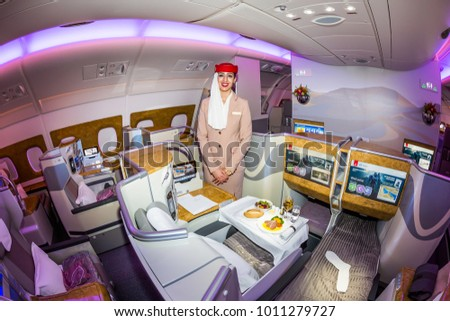 Dubai, UAE - NOVEMBER 12, 2017: Emirates Airline flight attendant. Emirates business class. Airplane food. Stewardess dress. Flight attendant portrait. Emirates airline travel. Onboard dining.
