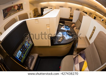 Dubai, UAE - NOVEMBER 09, 2015: Etihad Airways Airbus A380 business class luxury seats. Etihad airways business class. Business class amenities. Etihad IFE system on November 09, 2015 in Dubai - stock photo