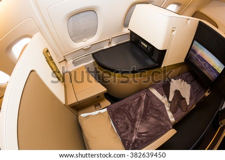 Dubai, UAE - NOVEMBER 09, 2015: Etihad Airways Airbus A380 business class seat. Business class travel. A380 business class interior. Reclined flat bed business class seat on November 09, 2015 in Dubai - stock photo