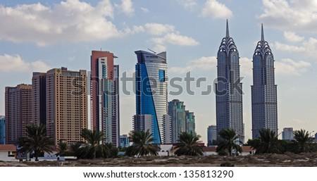 DUBAI, UAE-NOVEMBER 17: Evening view of the Chrysler building in Dubai on November 17, 2012. Dubai builds two imitations of NYC Chrysler building. - stock photo
