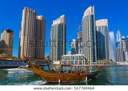 DUBAI, UAE - NOVEMBER 11: High rise buildings and streets nov 11. 2013  in Dubai, UAE. Dubai was the fastest developing city in the world between 2002 and 2008. - stock photo