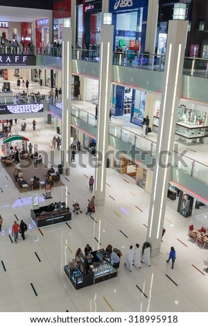 DUBAI, UAE - NOVEMBER 9, 2013: Inside modern luxuty mall . At over 12 million sq ft, it is the world's largest shopping mall based on total area.
