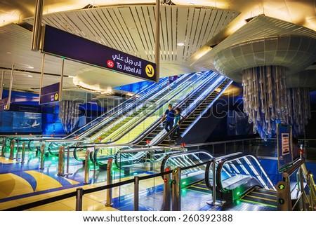 DUBAI, UAE - NOVEMBER 9: Interior of metro station in Dubai. Metro as world's longest fully automated metro network (75 km) on November 9, 2013, Dubai, UAE. - stock photo