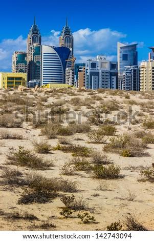 DUBAI, UAE - NOVEMBER 17: Midday heat in the desert in the background buildingsl on Nov 17, 2012 in Dubai UAE - stock photo