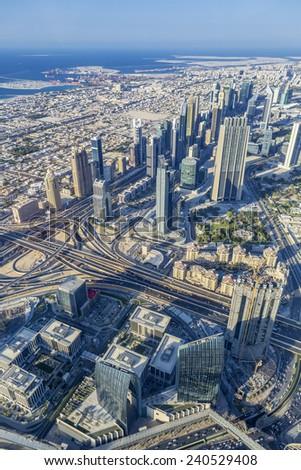 DUBAI, UAE - NOVEMBER 27: Modern buildings in Dubai , Dubai, UAE. View from the top of Burj A l Arab tower, taken on 27 November 2014 in Dubai.  - stock photo