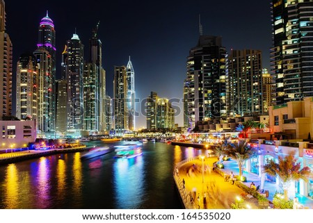 DUBAI, UAE - NOVEMBER 2: Modern buildings in Dubai Marina at night, on November 2, 2013, Dubai, UAE. In the city of artificial channel length of 3 kilometers along the Persian Gulf. - stock photo