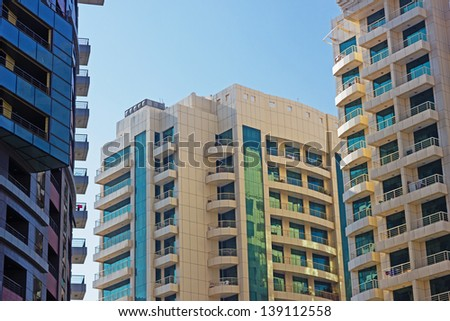 DUBAI, UAE - NOVEMBER 12: Modern buildings in Dubai Marina, on November 12, 2012, Dubai, UAE. Dubai was the fastest developing city in the world between 2002 and 2008.