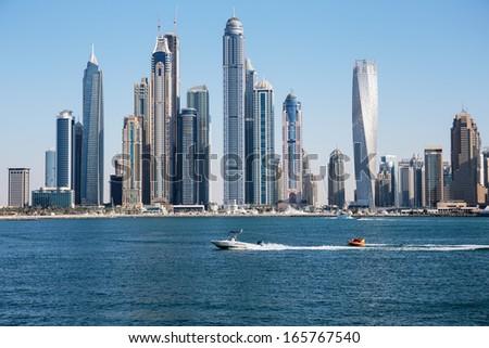 DUBAI, UAE - NOVEMBER 7: Modern buildings in Dubai Marina, on November 7, 2013, Dubai, UAE. In the city of artificial channel length of 3 kilometers along the Persian Gulf. - stock photo