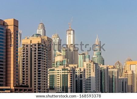 DUBAI, UAE - NOVEMBER 2: Modern buildings in Dubai, on November 2, 2013, Dubai, UAE. Dubai was the fastest developing city in the world between 2002 and 2008.