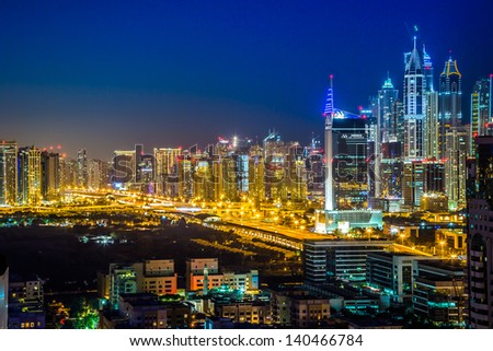 DUBAI, UAE - NOVEMBER 13: Modern skyscrapers in Dubai (emirate and city), UAE. Dubai now boasts more completed skyscrapers higher than 0,8 - 0,25 km than any other city, on 13 November 2012 in Dubai. - stock photo