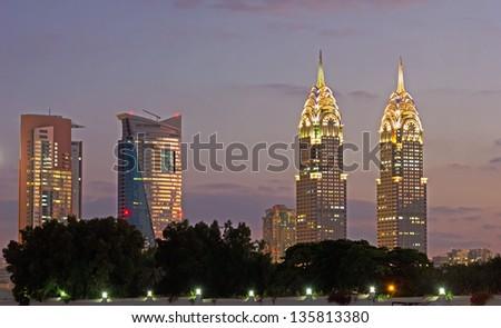 DUBAI, UAE-NOVEMBER 17: Night view of the Chrysler building in Dubai on November 17, 2012. Dubai builds two imitations of NYC Chrysler building. - stock photo