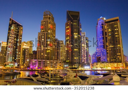 DUBAI, UAE - NOVEMBER 16: Night view Yacht Club in Dubai Marina, on November 16, 2012, Dubai, UAE. In the city of artificial channel length of 3 kilometers along the Persian Gulf.