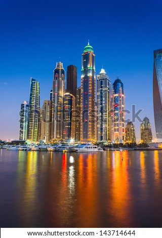 DUBAI, UAE - NOVEMBER 14: Nightlife in Dubai Marina. UAE. November 14, 2012. Dubai was the fastest developing city in the world between 2002 and 2008. - stock photo