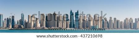 DUBAI, UAE - NOVEMBER 7: Panoramic view of the Dubai Marina, on November 7, 2013, Dubai, UAE. In the city of artificial channel length of 3 kilometers along the Persian Gulf. - stock photo