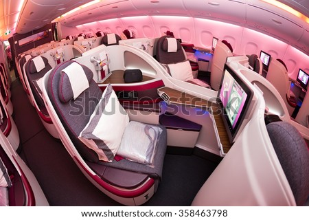 Dubai, UAE - NOVEMBER 10, 2015: Qatar Airways Airbus A380 business class luxury seats. Airbus A380 cabin, business class travelling on November 10, 2015 in Dubai - stock photo