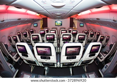 Dubai, UAE - NOVEMBER 10, 2015: Qatar Airways Airbus A380 economy class seats. Qatar Airways ORYX in flight entertainment sytem. Airline IFE. IFE displays on November 10, 2015 in Dubai - stock photo