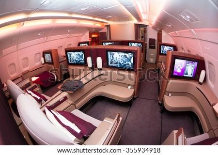 Dubai, UAE - NOVEMBER 10, 2015: Qatar Airways Airbus A380 first class luxury seats. ORYX inflight entertainment IFE. Business class travelling on November 10, 2015 in Dubai - stock photo