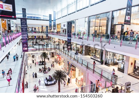 DUBAI, UAE - NOVEMBER 14: Shoppers at Dubai Mall on Nov 15, 2012 in Dubai. At over 12 million sq ft, it is the world's largest shopping mall based on total area and 6th largest by gross leasable area. - stock photo