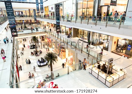 DUBAI, UAE - NOVEMBER 14: Shoppers at Dubai Mall on November 14, 2012 in Dubai. At over 12 million sq ft, it is world's largest shopping mall based on total area and 6th largest by gross leasable area - stock photo