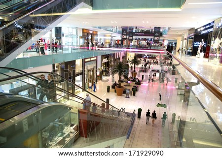 DUBAI, UAE - NOVEMBER 14: Shoppers at Dubai Mall on November 14, 2012 in Dubai. At over 12 million sq ft, it is world's largest shopping mall based on total area and 6th largest by gross leasable area